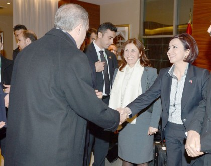 Prime Minister Erdogan shakes hands with Semiha Unal